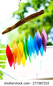Colorful glass wind chimes  on the nature background. Feng shui symbol