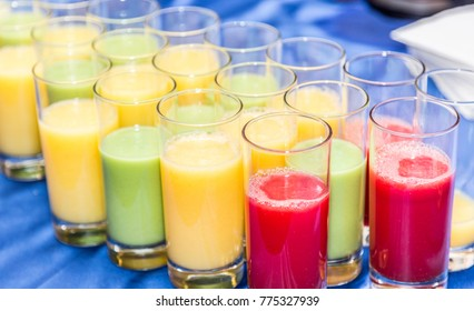 Colorful glasses of fruit juice. Close-up.