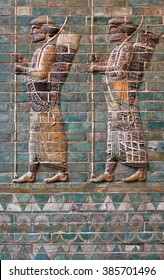 Colorful glazed brick frieze of Persian Achaemenid warriors from Susa of Iran.