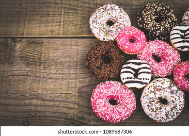 Colorful glazed donuts with sprinkles