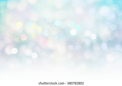 Colorful glitter blurred lights on white blue background.Xmas magic wallpaper.Horizon winter backdrop.Romantic illustration.