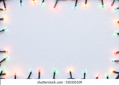 colorful glowing garland on white background Christmas frame mockup