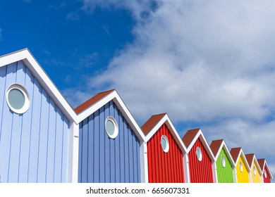 Colorful glowing houses front on the North Sea island Langeoog