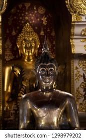 Colorful golden Asian Buddha images at Wat Padarapirom Chiangmai Thailand