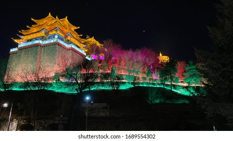Colorful Golden Temple or Dafo with colorful lighting at night in Shangri-La, Yunnan, China