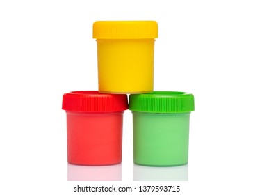 Colorful Gouache jars isolated on white background with copy space. Cans of different colors gouache paints.