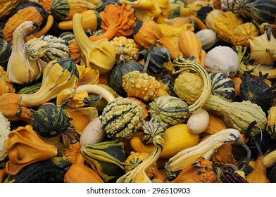 colorful gourds stacked on top of each other