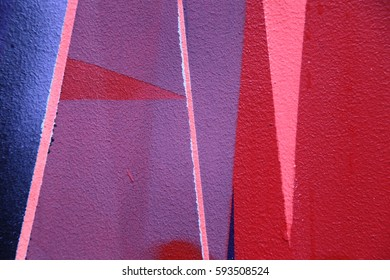 Colorful graffiti on the wall. Street art. Fragment for background. Detail of a graffiti