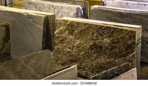Colorful granite and marble slabs for sale in store show room.