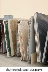 Colorful granite slabs for sale in store yard