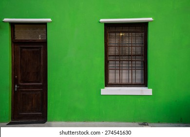 Colorful green home facade in the historic Bo-Kaap neighborhood in Cape Town, South Africa.  The area is also known as the Malay Quarter, known for its colorful homes.