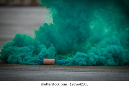 colorful green smoke bombs action in showing