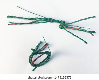 Colorful green twisted nylon rope vertical on a white background.
