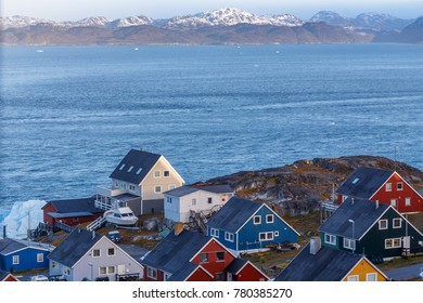 Colorful greenlandic houses at the ocean fjord. Nuuk, Greenland