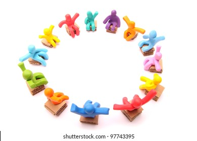 colorful group of plasticine people having a meeting sitting on chairs - isolated on white