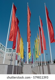 Colorful Groups of Flags against Blue Sky