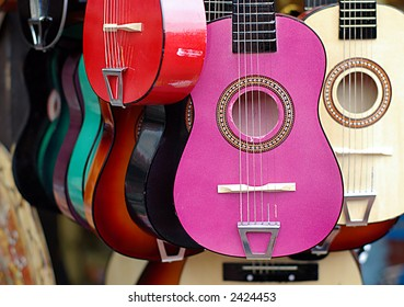 colorful guitars in musical instruments shop