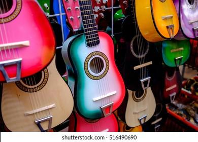 colorful guitars on display at souvenir shops in San Antonio, Texas.