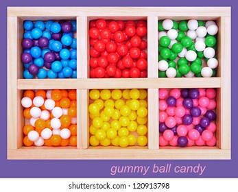 colorful gummy ball candy in wooden tray