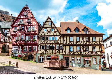 Colorful half-timbered houses on the market place (Alter Marktplatz) in old german town Miltenberg am Main river. Odenwald, Bavaria, Germany