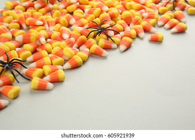 Colorful Halloween candies on light background