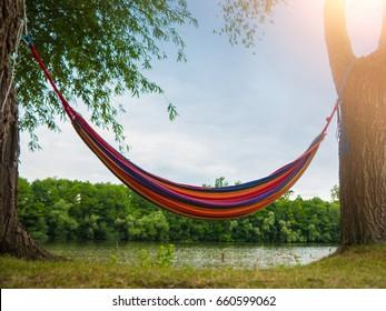 Colorful Hammock between two trees at a Lake