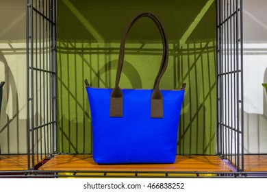 colorful hand bags on shelves