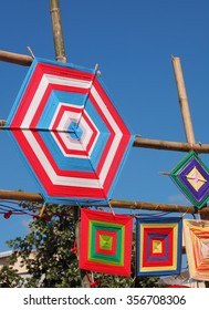 colorful hand made pattern of bamboo frame and color yarns as meaningful ritual decoration ornament in buddhism religion temple, ceremony and festivals in northern and north eastern THAILAND