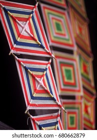 colorful hand made pattern of bamboo frame and color yarns as meaningful ritual decoration ornament use in buddhism religion temple, ceremony,  festivals in northern and north eastern THAILAND
