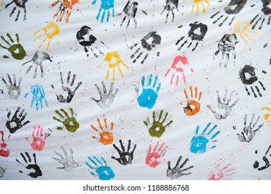 Colorful hand prints on white cloth
