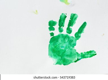 Colorful hand prints of toddler kid on white background. Set of rainbow colored hand prints.