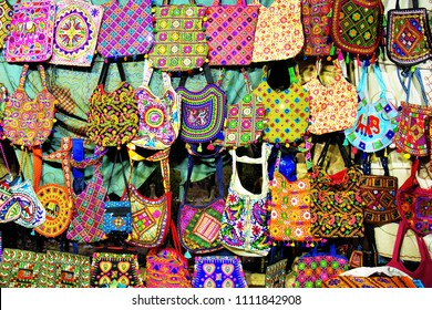 Colorful, handcrafted cotton hand bags for sale in the Law Garden night market, Ahmedabad.