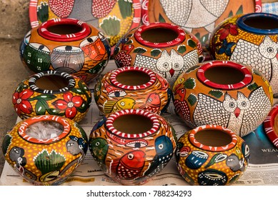 Colorful handicraft items made from clay by rural artisans for sale in India