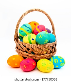 Colorful handmade easter eggs in the basket isolated on a white background