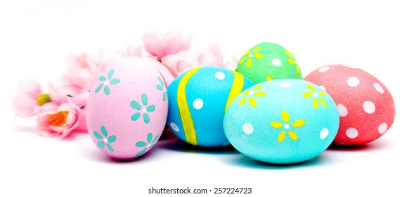 Colorful handmade easter eggs with flower isolated on a white