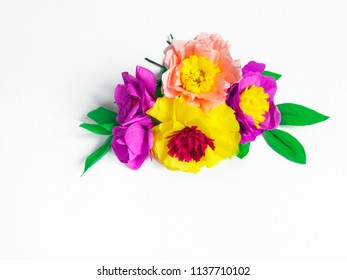 Colorful handmade flowers on a white background with copy space. Crepe paper. Master Class. St. Valentine's Day and Mother's Day. Decor for the holiday.