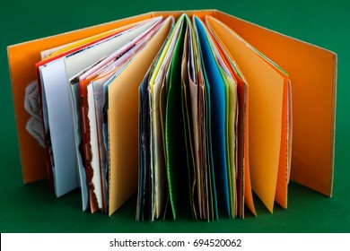 A colorful, handmade junk journal. Made from a recycled box and  random paper such as book pages, envelopes and wall paper.