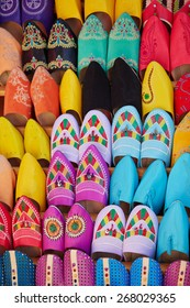 Colorful handmade leather slippers (babouches) on a market in Marrakech, Morocco