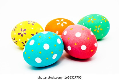 Colorful handmade painted easter eggs isolated on a white closeup