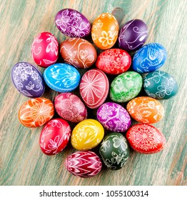 colorful handmade scratched easter eggs on wooden table