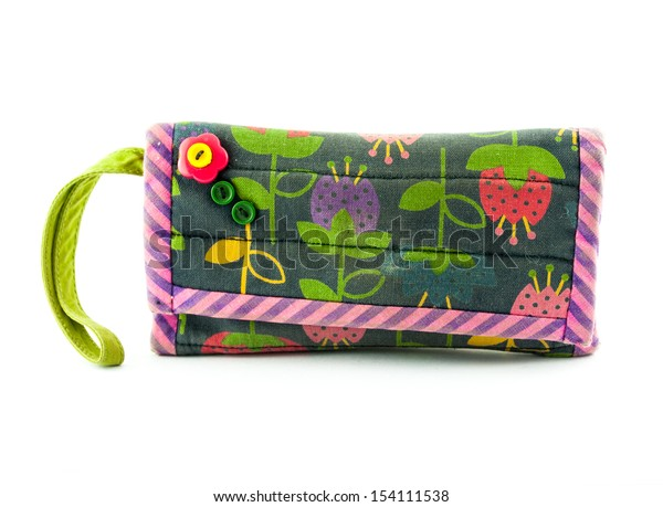 Colorful handmade of small fabric purse isolated on white