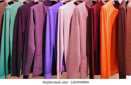 Colorful hanging display of cashmere sweaters in Italy