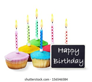 colorful happy birthday cupcakes with candles with compliments