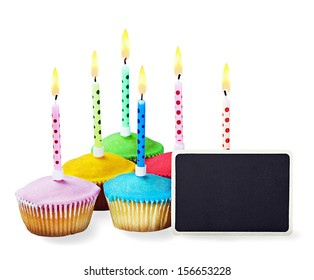 colorful happy birthday cupcakes with candles on white background