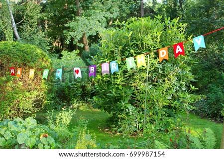 happy birthday garden Colorful Happy Birthday Flags Text Outdoor Stock Photo (Edit Now  happy birthday garden
