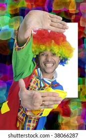Colorful and happy clown making a frame with is hands, with a background full of colors