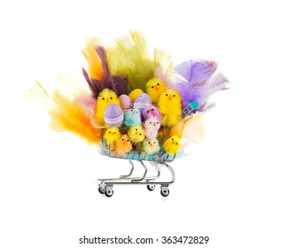 Colorful happy Easter chicken family, colorful easter eggs and feathers in a shopping shart. Happy Easter shopping.