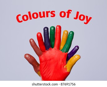 Colorful happy finger smileys with colours of joy sign on grey background