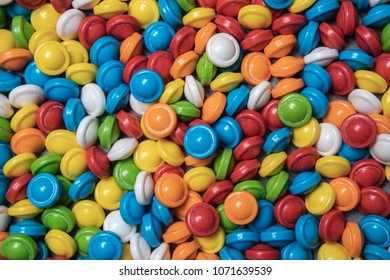 Colorful hard sugar coated candies background in bright colors of red, blue, green, orange, yellow and white