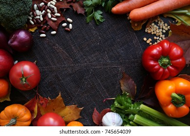 Colorful harvest vegetables and fruits on dark background